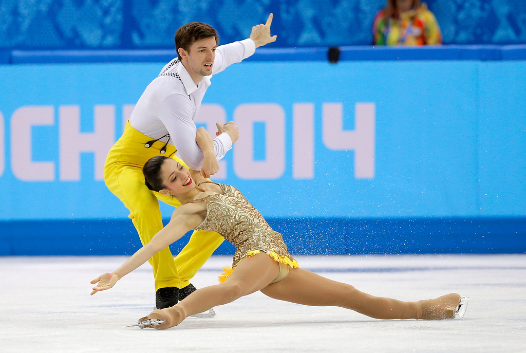 Description of . Stefania Berton and Ondrej Hotarek of Italy compete in the pairs short program figure skating competition at the Iceberg Skating Palace during the 2014 Winter Olympics, Tuesday, Feb. 11, 2014, in Sochi, Russia. (AP Photo/Vadim Ghirda)