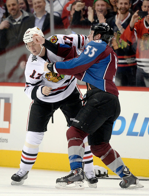 . Colorado wing Cody McLeod (55) took a swing at Chicago defenseman Sheldon Brookbank (17) in the first period. The Colorado Avalanche hosted the Chicago Blackhawks at the Pepsi Center Wednesday night, March 12, 2014 in Denver, Colorado. (Photo by Karl Gehring/The Denver Post)