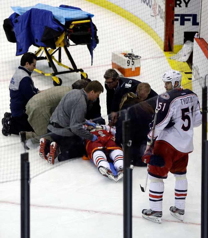 . Team doctors and emergency personnel tend to Columbus Blue Jackets center Artem Anisimov, of Russia, during the second period of an NHL hockey game against the Detroit Red Wings in Detroit, Thursday, Feb. 21, 2013. (AP Photo/Carlos Osorio)
