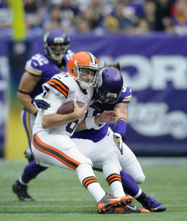 . Brian Robison #96 of the Minnesota Vikings sacks Brian Hoyer #6 of the Cleveland Browns during the first quarter of the game on September 22, 2013 at Mall of America Field at the Hubert H. Humphrey Metrodome in Minneapolis, Minnesota. (Photo by Hannah Foslien/Getty Images)