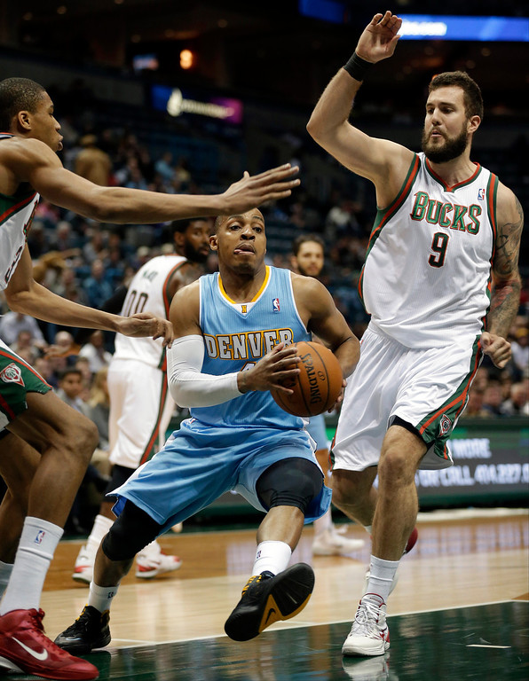 . Denver Nuggets\'  Randy Foye drives against Milwaukee Bucks\' Miroslav Raduljica (9) during the first half of an NBA basketball game Thursday, Feb. 20, 2014, in Milwaukee. (AP Photo/Jeffrey Phelps)