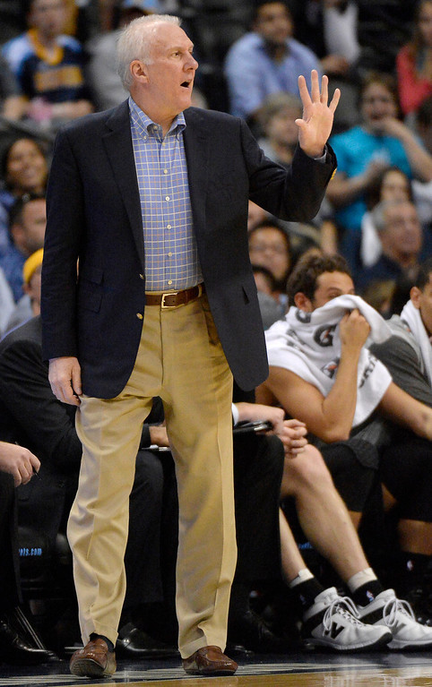 . San Antonio Spurs head coach Gregg Popovich signals a play to the his team against the Denver Nuggets in the first quarter October 14, 2013 at Pepsi Center. (Photo By John Leyba/The Denver Post)