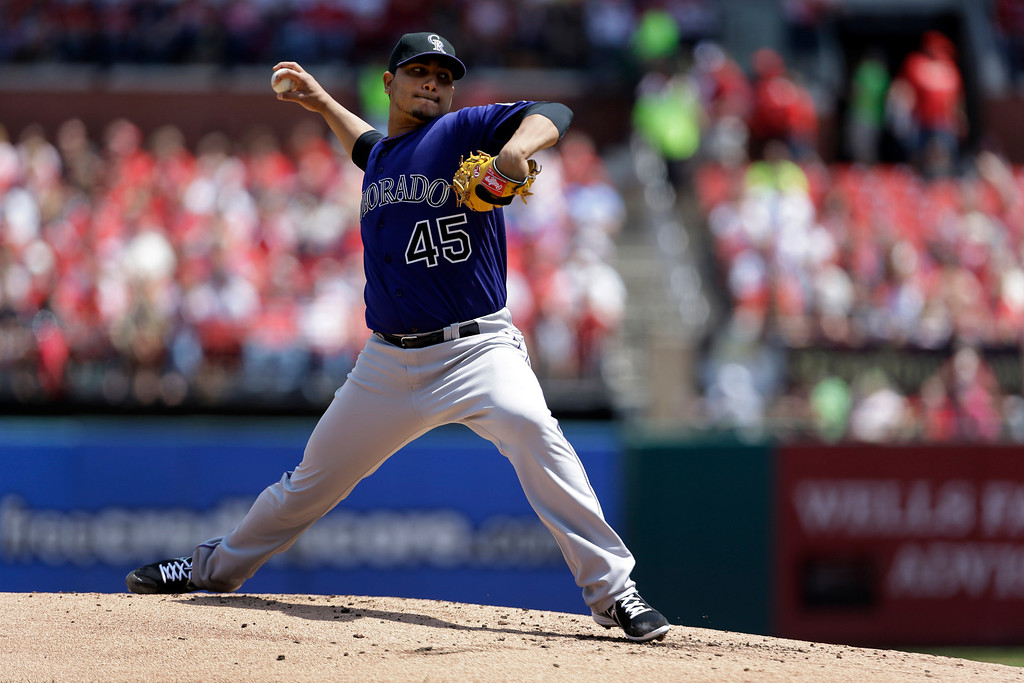 . Colorado Rockies starting pitcher Jhoulys Chacin throws during the first inning of a baseball game against the St. Louis Cardinals Saturday, May 11, 2013, in St. Louis. (AP Photo/Jeff Roberson)
