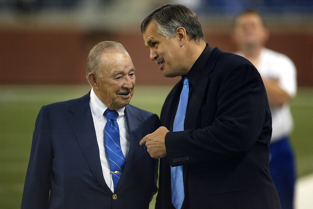 . Detroit Lions owner and Chairman William Clay Ford, left, shares a laugh with Lions President and C.E.O. Matt Millen, right, before a game against the Philadelphia Eagles, Sunday Sept. 26, 2004. (AP Photo/Jon M. Brouwer/The Grand Rapids Press)