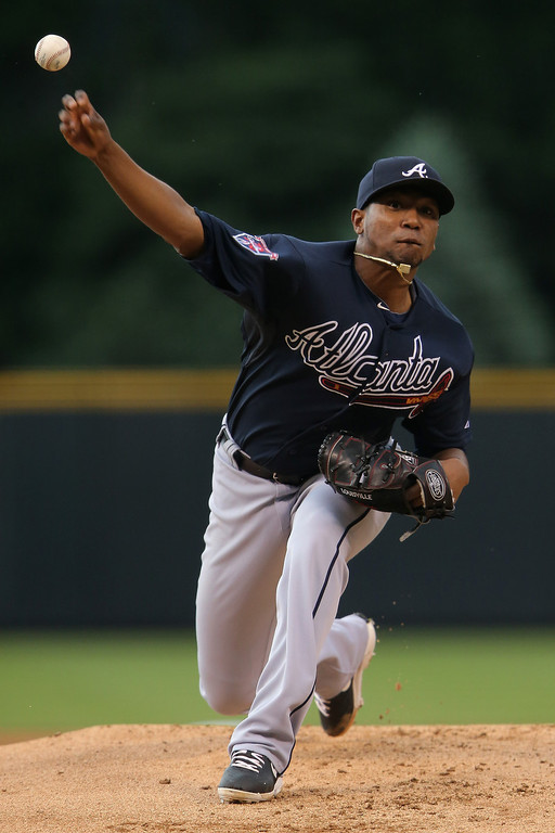 . Starting pitcher Julio Teheran #49 of the Atlanta Braves delivers against the Colorado Rockies at Coors Field on June 11, 2014 in Denver, Colorado.  (Photo by Doug Pensinger/Getty Images)