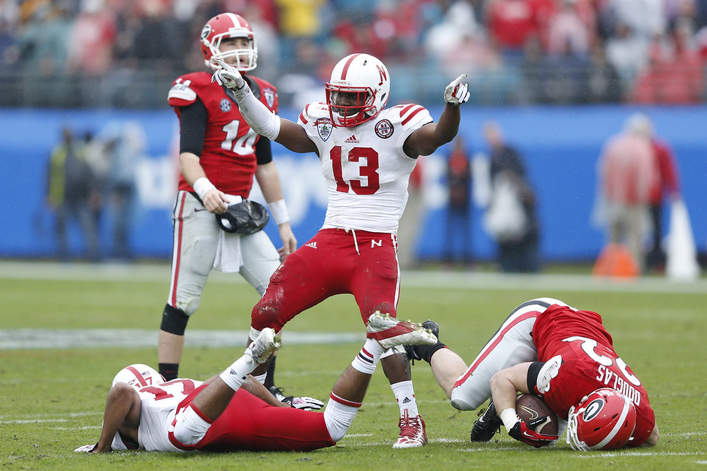. Zaire Anderson #13 of the Nebraska Cornhuskers celebrates after tackling Brendan Douglas #22 of the Georgia Bulldogs in the first half during the TaxSlayer.com Gator Bowl at Everbank Field on January 1, 2014 in Jacksonville, Florida. (Photo by Joe Robbins/Getty Images)