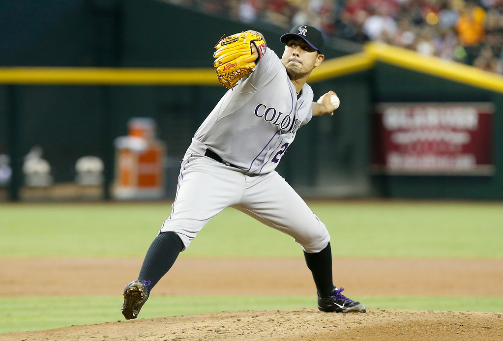 . Colorado Rockies\' Jorge De La Rosa delivers a pitch against the Arizona Diamondbacks in the first inning of a baseball game, Saturday, Aug. 9, 2014, in Phoenix. (AP Photo/Darryl Webb)