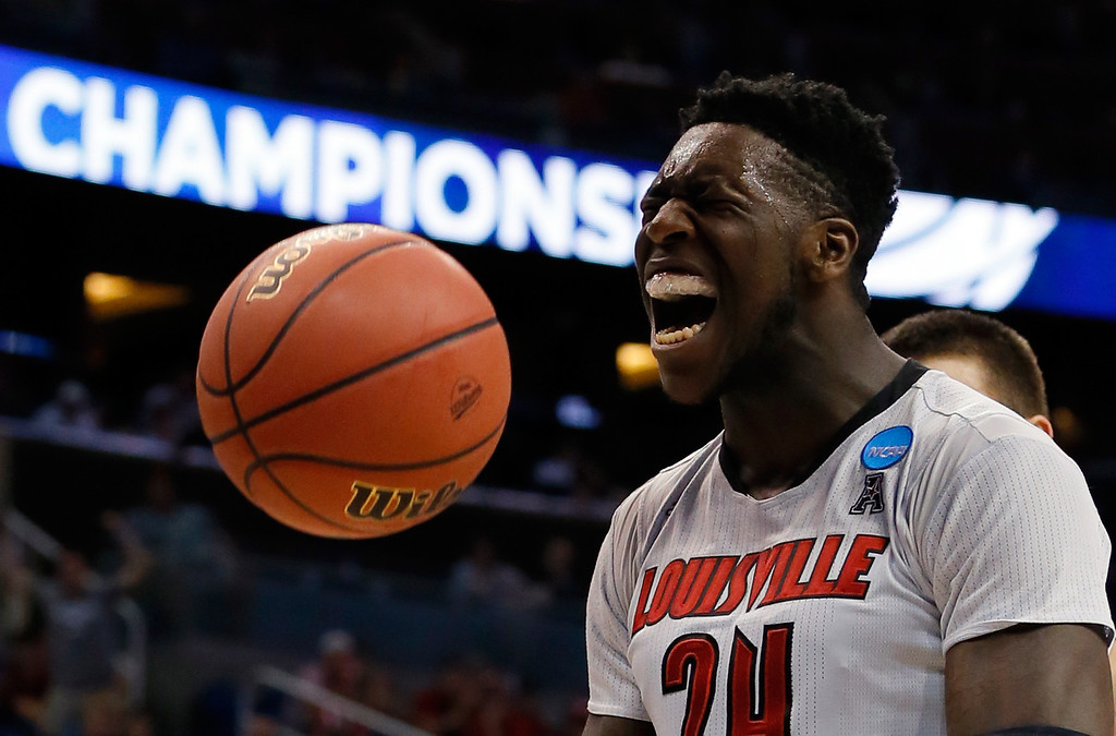 . ORLANDO, FL - MARCH 20:  Montrezl Harrell #24 of the Louisville Cardinals celebrates after a basket and the foul in the first half against the Manhattan Jaspers during the second round of the 2014 NCAA Men\'s Basketball Tournament at Amway Center on March 20, 2014 in Orlando, Florida.  (Photo by Kevin C. Cox/Getty Images)