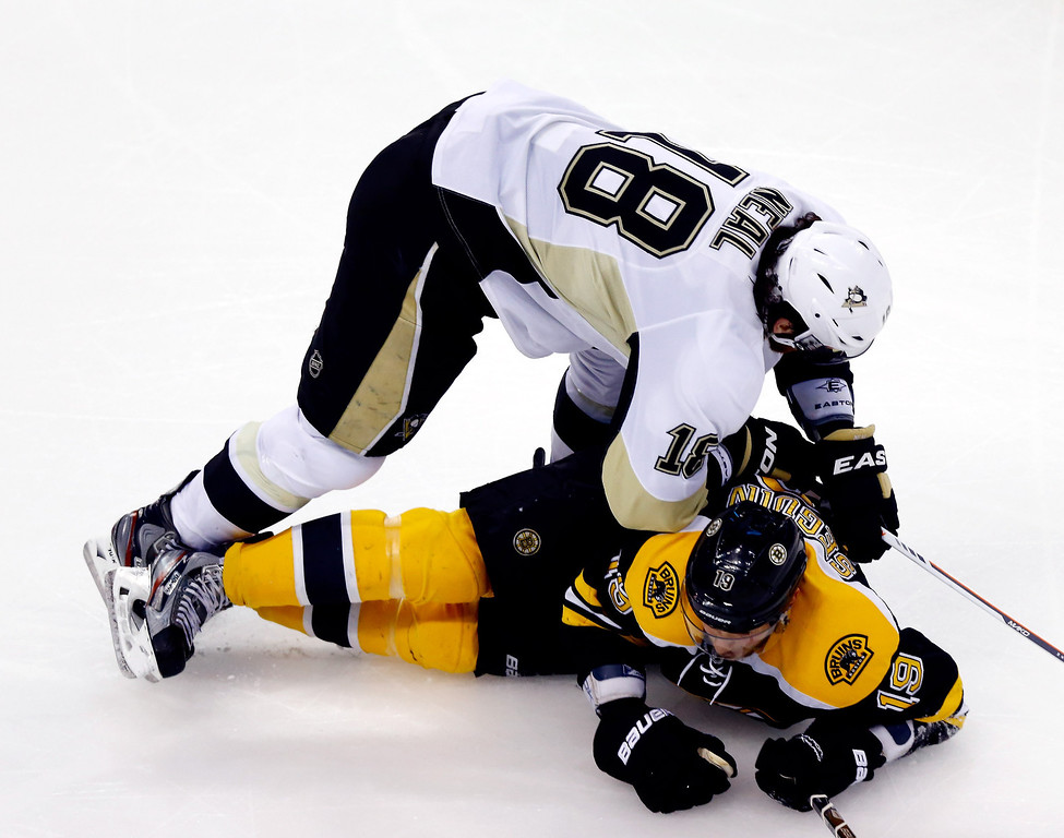 . James Neal #18 of the Pittsburgh Penguins checks Tyler Seguin #19 of the Boston Bruins during Game Three of the Eastern Conference Final of the 2013 NHL Stanley Cup Playoffs at the TD Garden on June 5, 2013 in Boston, Massachusetts.  (Photo by Jared Wickerham/Getty Images)