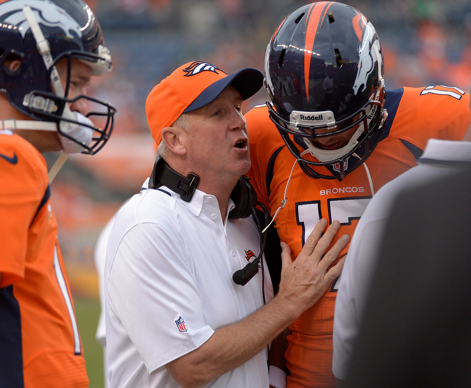 . Denver Broncos head coach John Fox chats with Denver Broncos quarterback Brock Osweiler (17) during the fourth quarter in a game the Broncos would win 52-20. The Denver Broncos took on the Philadelphia Eagles at Sports Authority Field at Mile High in Denver on September 29, 2013. (Photo by Joe Amon/The Denver Post)