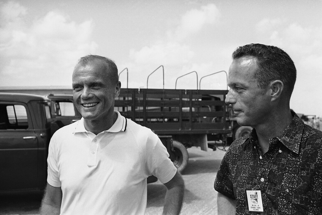 . Astronaut Scott Carpenter, right, looks toward John Glenn while they posed for photographers after Glenn was debriefed after his historic triple orbit flight around the earth, Feb. 21, 1962, Grand Turk Island, Turks and Caicos Islands. Carpenter was the backup pilot for Glenns flight. (AP Photo)