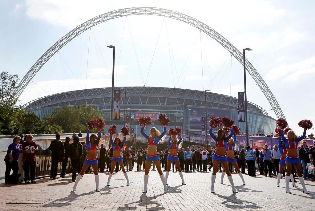 . The NFL Allstars cheerleaders perform ahead of the NFL game between the Pittsburgh Steelers and Minnesota Vikings  at Wembley Stadium, London, Sunday, Sept. 29, 2013.  (AP Photo/Sang Tan)