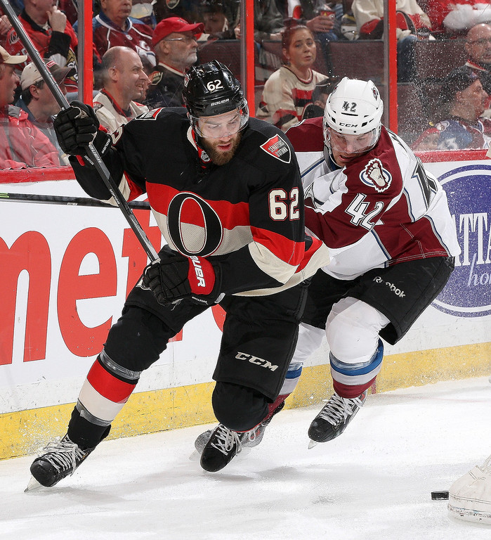 . Eric Gryba #62 of the Ottawa Senators skates for the loose puck as Brad Malone #42 of the Colorado Avalanche closes in on him during an NHL game at Canadian Tire Centre on March 16, 2014 in Ottawa, Ontario, Canada.  (Photo by Jana Chytilova/Freestyle Photography/Getty Images)