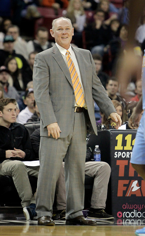 . Denver Nuggets head coach George Karl smiles as he watches his team  against the Sacramento Kings during the third quarter of an NBA basketball game in Sacramento, Calif., Sunday, Dec. 16, 2012.  The Nuggets won 122-97.(AP Photo/Rich Pedroncelli)