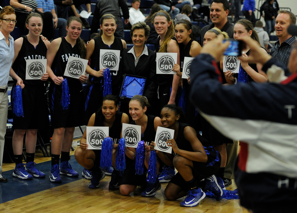 . PARKER, CO. - FEBRUARY 15: Falcon\'s players posed for a team shot after the historic win Friday night. The Highlands Ranch High School girls\'s basketball team defeated Legend 76-31 Friday night, February 15, 2013. Falcon\'s coach Caryn Jarocki earned her 500th career win. (Photo By Karl Gehring/The Denver Post)