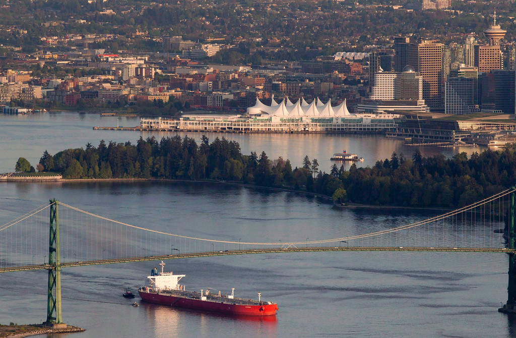 . A oil tanker is guided by tug boats as it goes under the Lions Gate Bridge at the mouth of Vancouver Harbor on May 5, 2012.  (AP Photo/The Canadian Press, Jonathan Hayward)