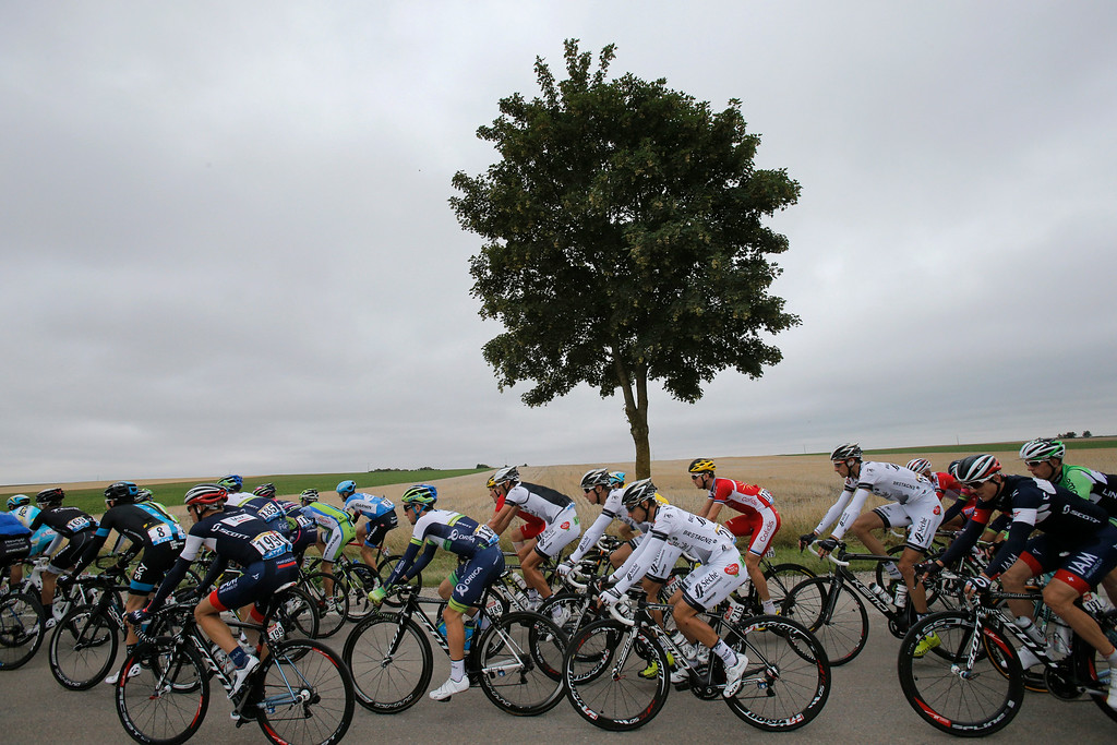 . The rides pedal in the pack during the seventh stage of the Tour de France cycling race over 234.5 kilometers (145.7 miles) with start in Epernay and finish in Nancy, France, Friday, July 11, 2014. (AP Photo/Christophe Ena)