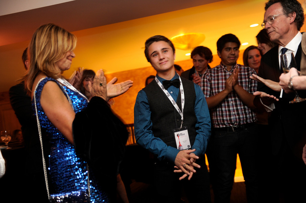 . DENVER, CO. - NOVEMBER 6: Teen actor Gattlin Griffith, center, acknowledged applause during opening night festivities for the 36th Starz Film Festival which opened Wednesday night, November 6, 2013 with a showing of the movie Labor Day. Grifith stars in the film with Josh Brolin and Kate Winslet. Griffith received the Rising Star award Wednesday night from the festival.  At left is Joyce Maynard who wrote the book on which the movie is based. Photo By Karl Gehring/The Denver Post