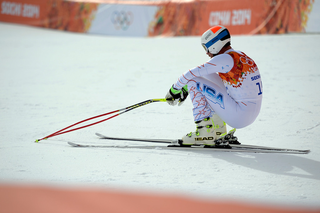. SOCHI, RUSSIA - FEBRUARY 09: United States skier Bode Miller squats in disappointment after failing to crack the top three during the alpine skiing men\'s downhill final. Sochi 2014 Winter Olympics at the Rosa Khutor Alpine Resort on Sunday, February 9, 2014. (Photo by AAron Ontiveroz/The Denver Post)