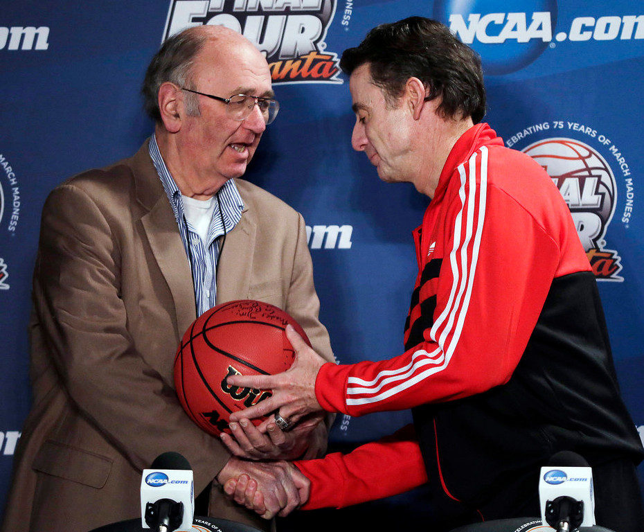 . AP Basketball Writer Jim O\'Connell, left, is honored by Louisville coach Rick Pitino after a news conference for the NCAA Final Four tournament, Sunday, April 7, 2013, in Atlanta. Louisville plays Michigan in the basketball championship game on Monday. Covering his 35th Final Four, AP Basketball Writer Jim O\'Connell was honored by the NCAA and the Final Four coaches today. (AP Photo/Chris O\'Meara)