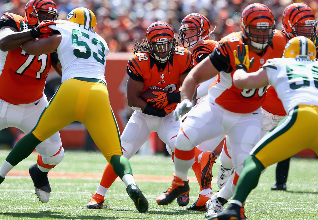 . Ben Jarvus Green-Ellis #42 of the Cincinnati Bengals runs with the ball during the NFL game against the Green Bay Packers at Paul Brown Stadium on September 22, 2013 in Cincinnati, Ohio.  (Photo by Andy Lyons/Getty Images)