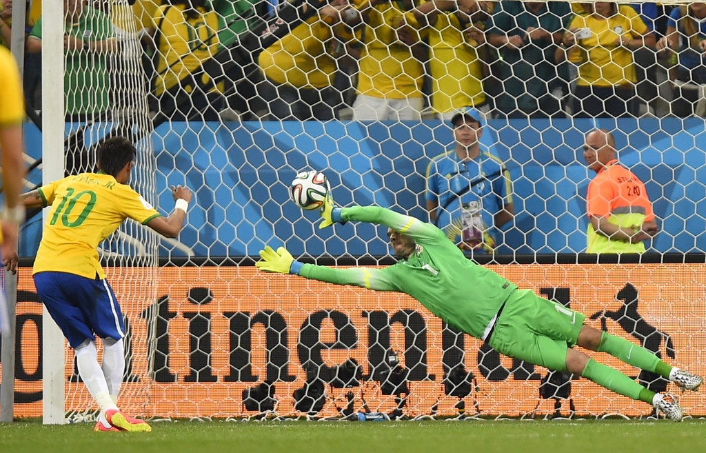 . Brazil\'s forward Neymar (L) scores from the penalty spot past Croatia\'s goalkeeper Stipe Pletikosa during a Group A football match between Brazil and Croatia at the Corinthians Arena in Sao Paulo during the 2014 FIFA World Cup on June 12, 2014.FABRICE COFFRINI/AFP/Getty Images