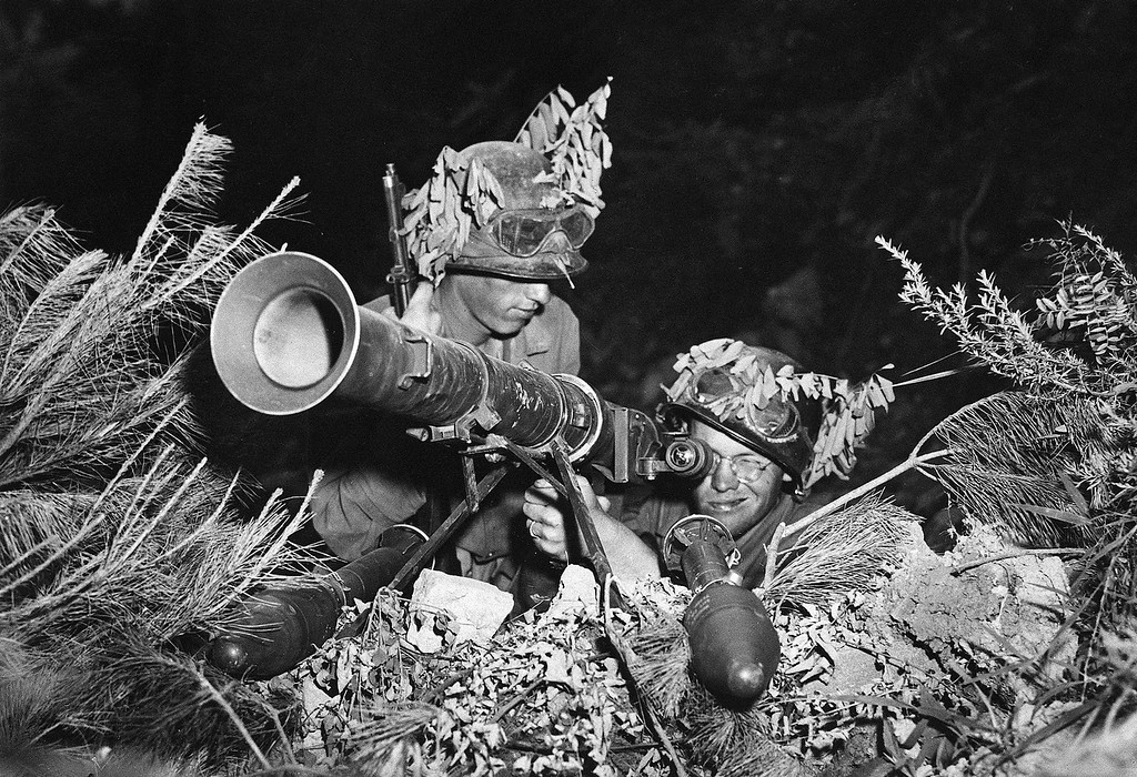 . Two American soldiers line up a 3.5 rocket launcher bazooka along the battlefront somewhere in Korea, July 24, 1950.  (AP Photo)