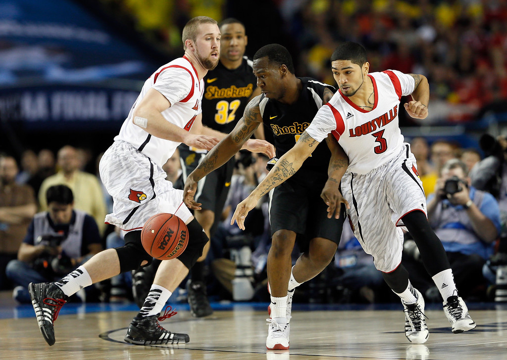 . ATLANTA, GA - APRIL 06:  Malcolm Armstead #2 of the Wichita State Shockers attempts to control the ball in the second half against Stephan Van Treese #44 (L) and Peyton Siva #3 of the Louisville Cardinals during the 2013 NCAA Men\'s Final Four Semifinal at the Georgia Dome on April 6, 2013 in Atlanta, Georgia.  (Photo by Kevin C. Cox/Getty Images)