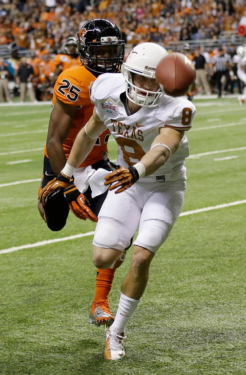 . Texas\' Jaxon Shipley (8) misses a pass as Oregon State\'s Ryan Murphy (25) defends during the first quarter of the Alamo Bowl NCAA football game, Saturday, Dec. 29, 2012, in San Antonio.  (AP Photo/Eric Gay)