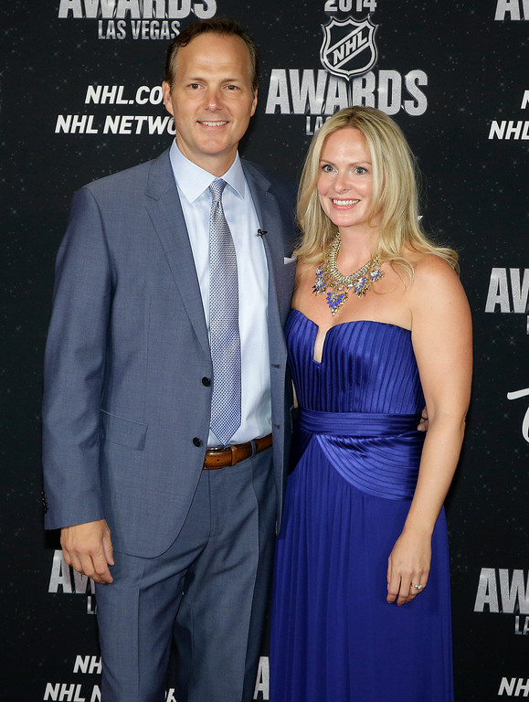 . Jon Cooper of the Tampa Bay Lightning poses with his wife, Jessie, on the red carpet before the NHL Awards at the Wynn Tuesday, June 24, 2014, in Las Vegas. (AP Photo/John Locher)