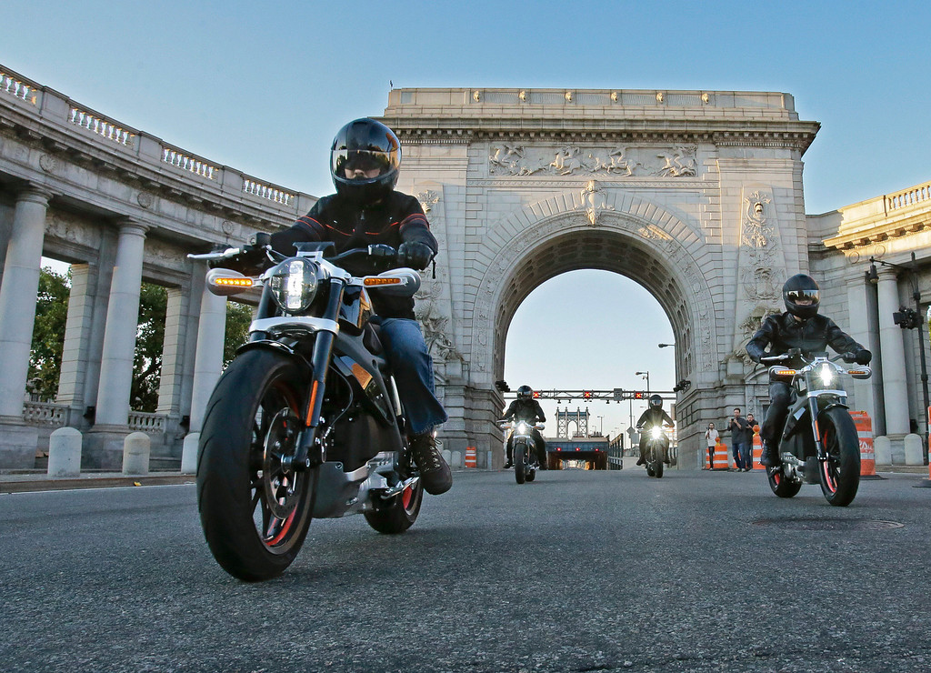 . In this photo provided by Harley-Davidson, riders introduce Project LiveWire the first electric Harley-Davidson motorcycle as they cross the Manhattan Bridge in New York, Monday, June 23, 2014. While not for sale, starting today, select consumers across the United States will be able to ride and provide feedback on the new motorcycle during a series of events scheduled through the remainder of the year. Harley said it will likely be several years before its LiveWire goes on sale. (AP Photo/Harley-Davidson, Ray Stubblebine)