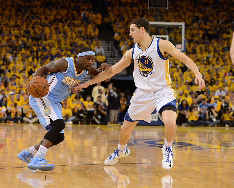 . OAKLAND, CA. - APRIL 26: Ty Lawson (3) of the Denver Nuggets looks to drive on Klay Thompson (11) of the Golden State Warriors during the second quarter  in game 3 of the first round of the NBA Playoffs April 26, 2013 at Oracle Arena.  (Photo By John Leyba/The Denver Post)