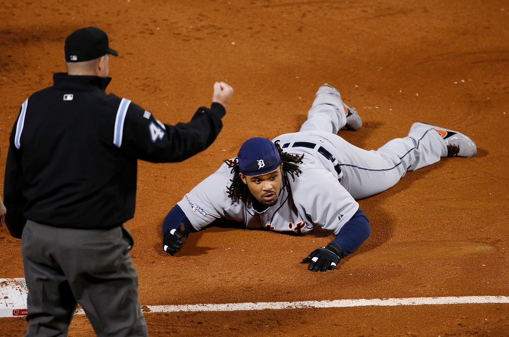 . Third base umpire Ron Kulpa signals an out by Detroit Tigers first baseman Prince Fielder in the sixth inning during Game 6 of the American League baseball championship series on Saturday, Oct. 19, 2013, in Boston. (AP Photo/Elise Amendola)
