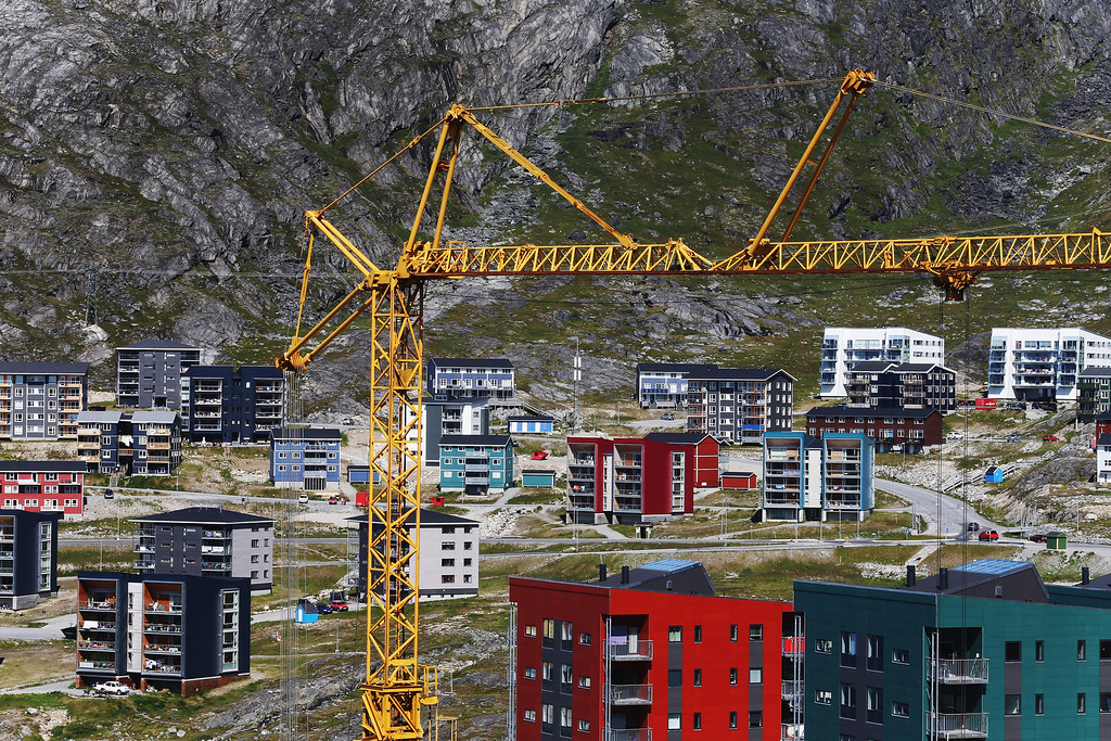 . Construction cranes are seen as new apartment buildings are built into the mountains on July 29, 2013 in Nuuk, Greenland. (Photo by Joe Raedle/Getty Images)