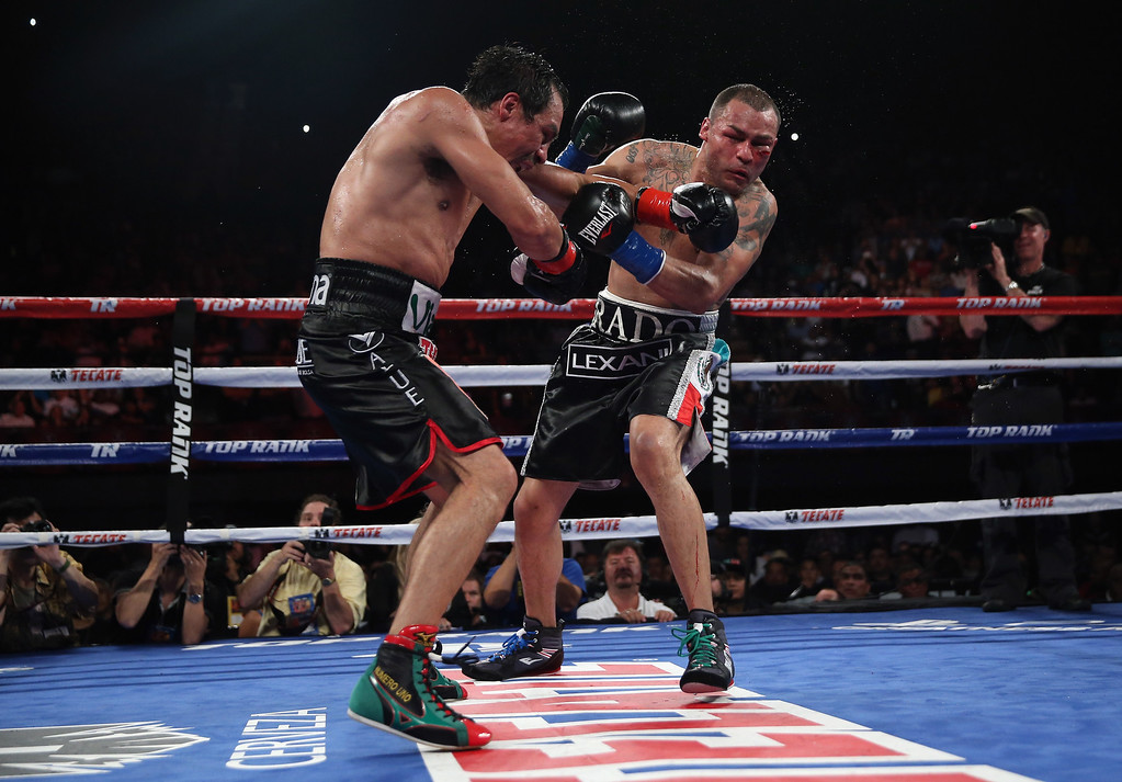 . INGLEWOOD, CA - MAY 17:  Juan Manuel Marquez (L) lands a left hand to the chin of Mike Alvarado at The Forum on May 17, 2014 in Inglewood, California.  (Photo by Jeff Gross/Getty Images)