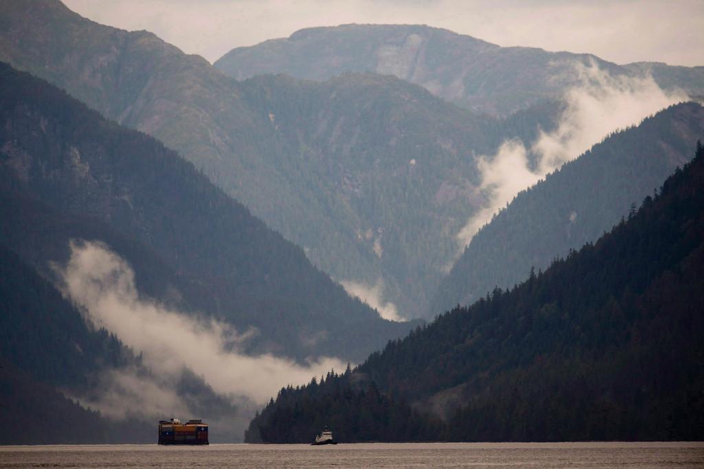 . A tug tows a large barge along Princess Royal Island, B.C., Sept, 19, 2013.    (AP Photo/The Canadian Press, Jonathan Hayward)