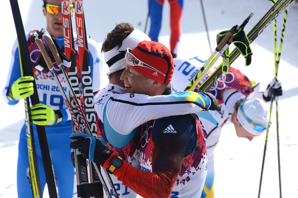 . Gold winner Russia\'s Alexander Legkov (R) is congratulated by Sweden\'s Anders Soedergren  following his win in the Men\'s Cross-Country Skiing 50km Mass Start Free at the Laura Cross-Country Ski and Biathlon Center during the Sochi Winter Olympics on February 23, 2014, in Rosa Khutor, near Sochi.   AFP PHOTO / KIRILL KUDRYAVTSEVKIRILL KUDRYAVTSEV/AFP/Getty Images