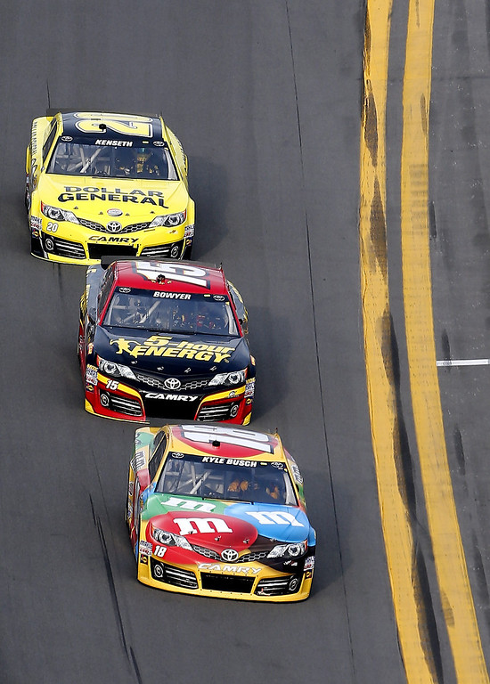 . Kyle Busch, driver of the #18 M&M\'s Toyota, leads Clint Bowyer, driver of the #15 5-hour ENERGY Toyota, and Matt Kenseth, driver of the #20 Dollar General Toyota, during the NASCAR Sprint Cup Series Budweiser Duel 2 at Daytona International Speedway on February 21, 2013 in Daytona Beach, Florida.  (Photo by Sam Greenwood/Getty Images)