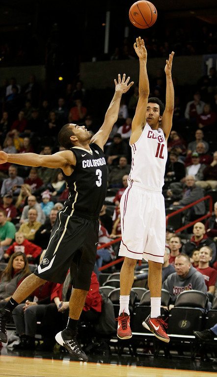. Washington State\'s Dexter Kernich-Drew (10) attempts a jump shot against Colorado\'s Xavier Talton (3) during the first half of an NCAA college basketball game Wednesday, Jan. 8, 2014, in Spokane, Wash. (AP Photo/Young Kwak)