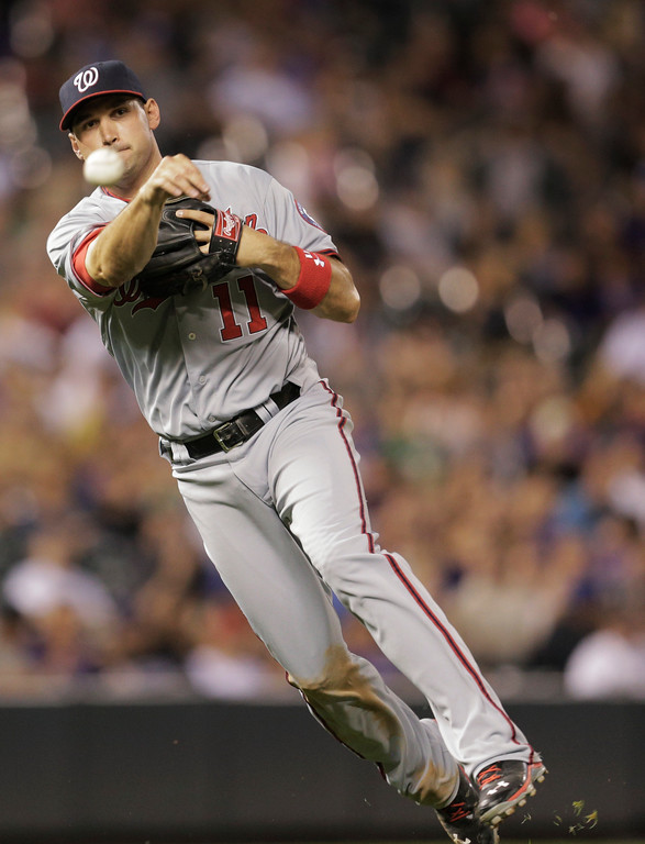 . Washington Nationals third baseman Ryan Zimmerman throws out Colorado Rockies\' Noland Arenado, not shown, on a ground ball in the sixth inning of a baseball game on Wednesday, June 12, 2013 in Denver. (AP Photo/Joe Mahoney)