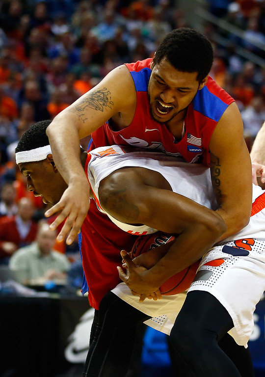 . BUFFALO, NY - MARCH 22: C.J. Fair #5 of the Syracuse Orange holds the ball as Jalen Robinson #12 of the Dayton Flyers defends during the third round of the 2014 NCAA Men\'s Basketball Tournament at the First Niagara Center on March 22, 2014 in Buffalo, New York.  (Photo by Jared Wickerham/Getty Images)
