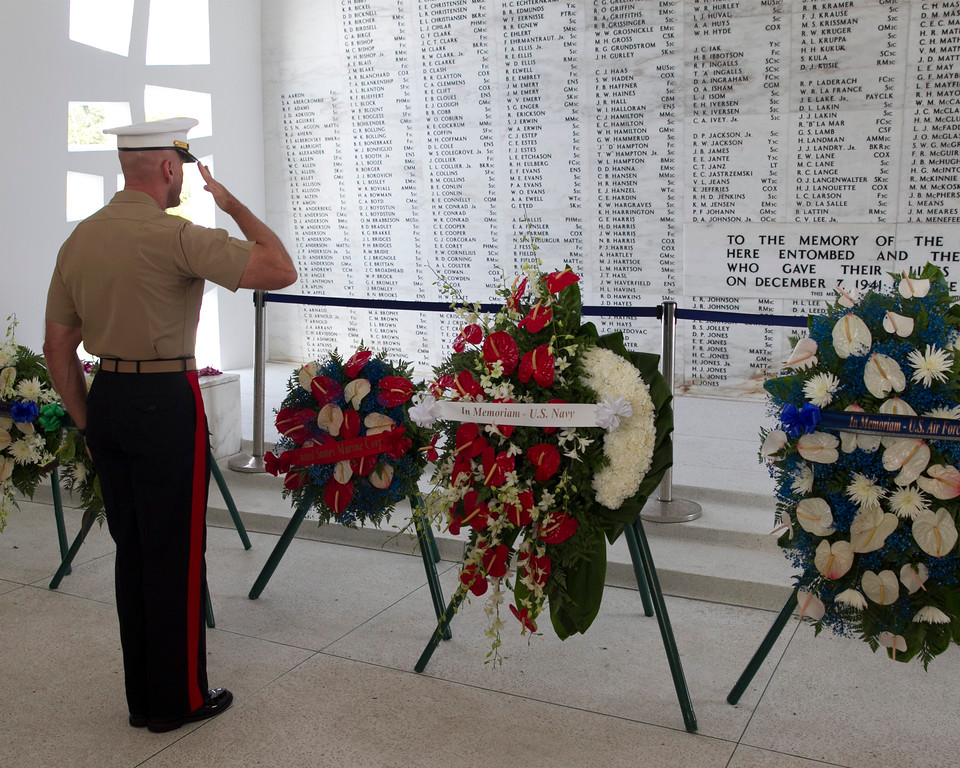 . US Marines Brig Gen Richard Simcock salutes a flower wreath in the memorial room aboard the USS Arizona Memorial during the ceremony commemorating the 72nd anniversary of the attack on Pearl Harbor, Saturday, Dec. 7, 2013, in Honolulu.  (AP Photo/Marco Garcia)