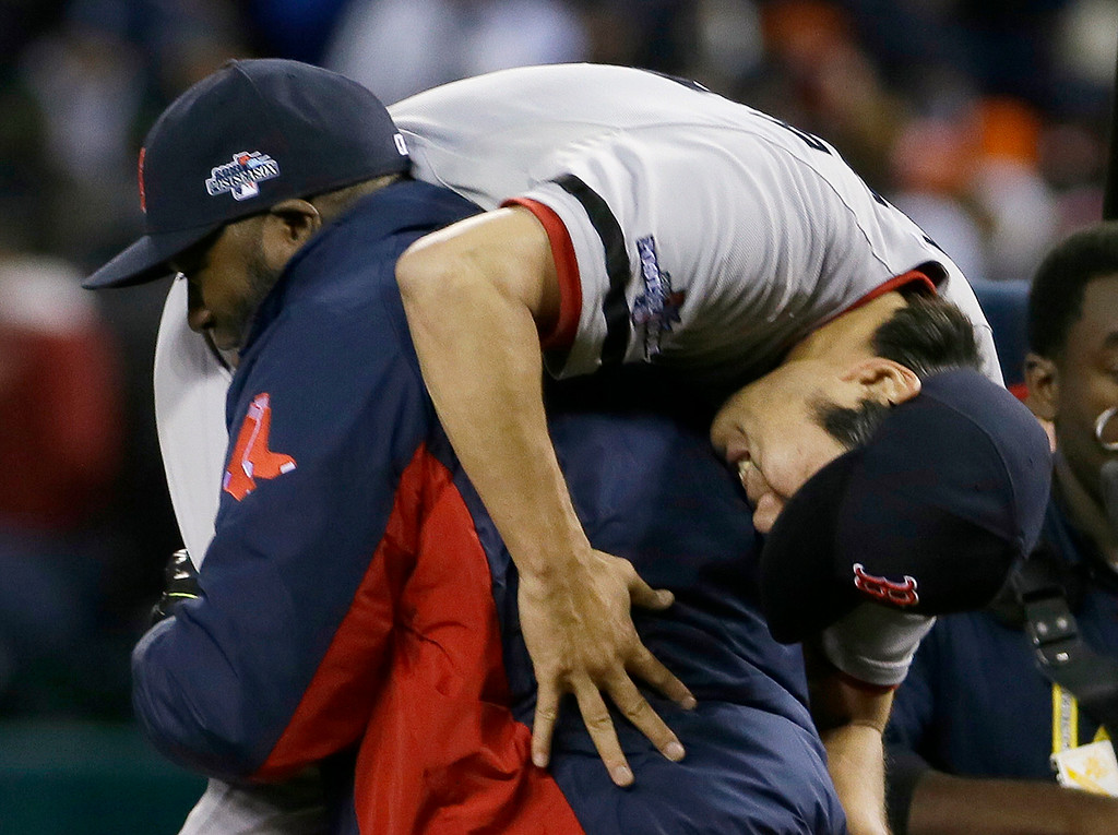 . Boston Red Sox\'s David Ortiz picks up Koji Uehara after the Red Sox defeating the Detroit Tigers 4-3 in Game 5 of the American League baseball championship series Thursday, Oct. 17, 2013, in Detroit.  (AP Photo/Matt Slocum)
