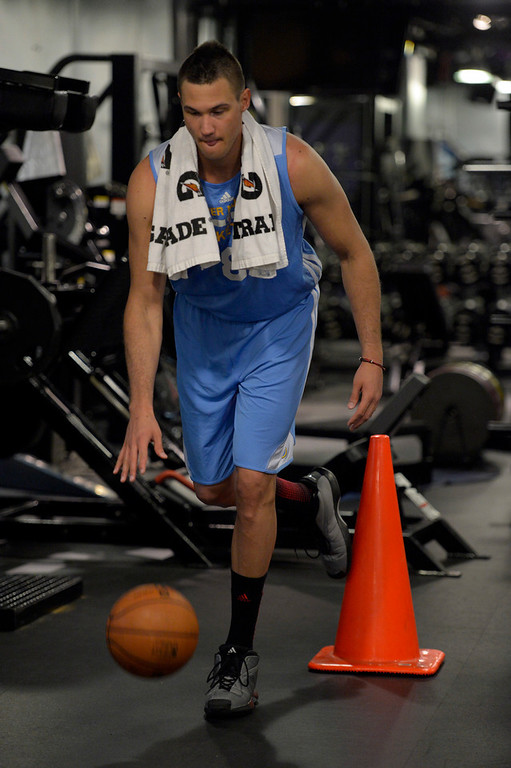 . Denver Nuggets Danilo Gallinari dribbles a basketball while balancing on one leg as he goes through a rigorous workout May 27, 2014 at Pepsi Center. (Photo by John Leyba/The Denver Post)