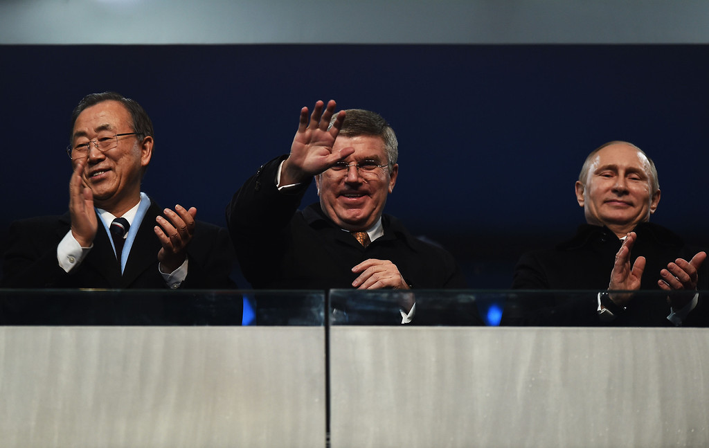 . nternational Olympic Committee (IOC) President Thomas Bach (C), Russian President Vladimir Putin (R) and UN Secretary General Ban Ki-moon wave to the crowd during the Opening Ceremony of the Sochi 2014 Winter Olympics at Fisht Olympic Stadium on February 7, 2014 in Sochi, Russia.  (Photo by Pascal Le Segretain/Getty Images)