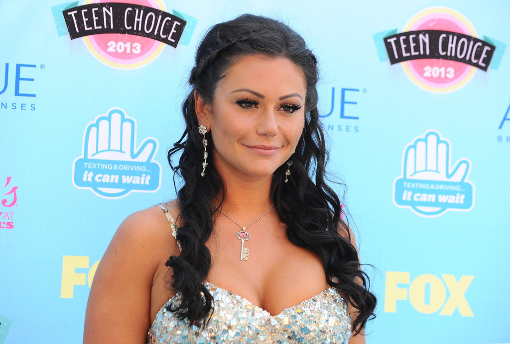 ". Jenni ""Jwoww\"" Farley arrives at the Teen Choice Awards at the Gibson Amphitheater on Sunday, Aug. 11, 2013, in Los Angeles.  (Photo by Jordan Strauss/Invision/AP)"