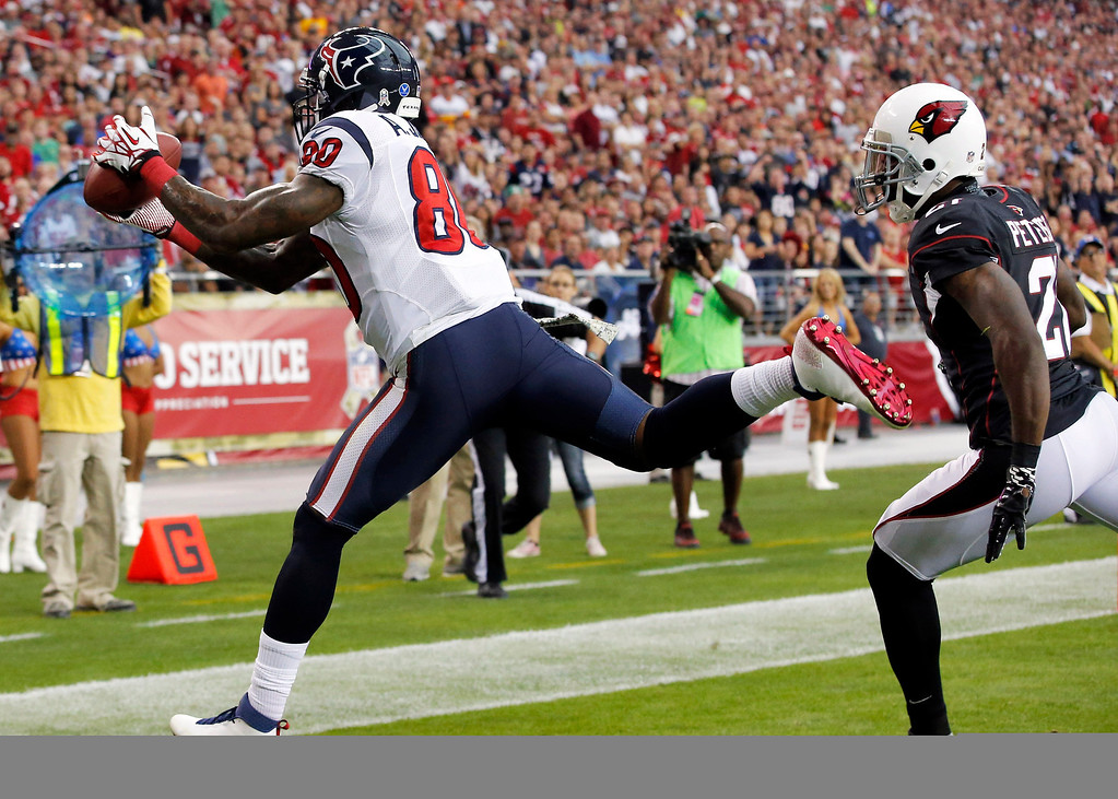 . Houston Texans wide receiver Andre Johnson, left, makes a touchdown catch as Arizona Cardinals cornerback Patrick Peterson defends during the first half of an NFL football game Sunday, Nov. 10, 2013, in Glendale, Ariz. (AP Photo/Ross D. Franklin)
