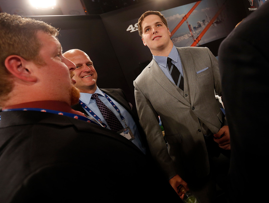 . Luke Joeckel, right, from Texas A&M, stands in the green room before the first round of the NFL football draft, Thursday, April 25, 2013 at Radio City Music Hall in New York.  (AP Photo/Jason DeCrow)