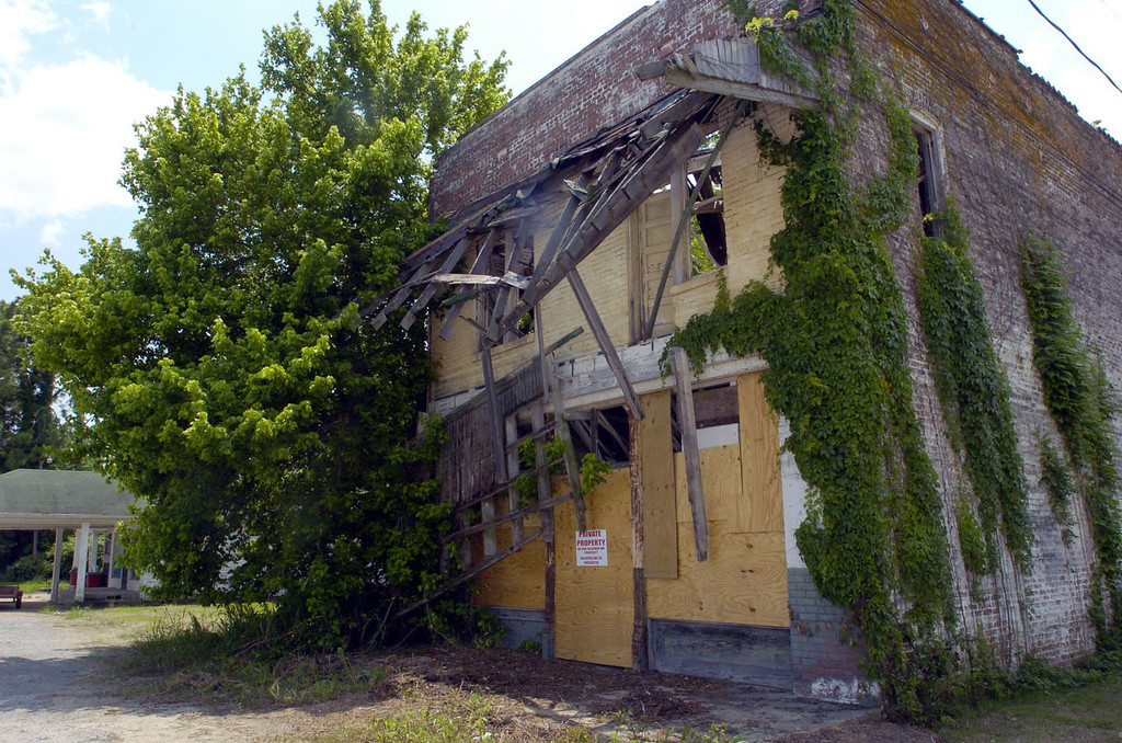 . Boarded up windows, fallen timbers, and an overgrowth of area vegetation decorate all that remains of Bryant\'s Grocery and Meat Market in Money, Miss., Monday, May 10, 2004. The Justice Department said Monday, it is reopening the investigation into the 1955 murder of Emmett Till, a teenager whose death while visiting relatives in Mississippi was an early catalyst for the civil rights movement. Allegedly Till, a Chicago youth, whistled at a white woman in the store. Roy Bryant, the store\'s owner and his half brother J.W. Milam, went to the home of Till\'s granduncle, abducted the teen, drove him to a neighboring county and killed him. (AP Photo/Rogelio Solis)