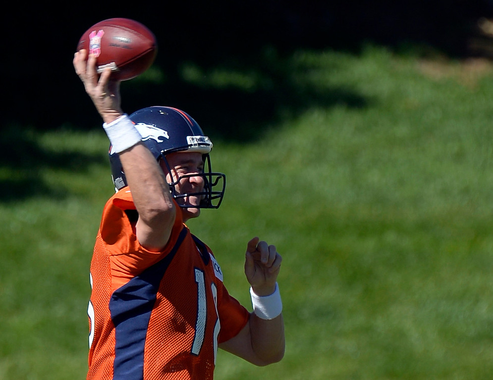 . Denver Broncos quarterback Peyton Manning (18) throws a pass during practice October 2, 2013 at Dove Valley. (Photo by John Leyba/The Denver Post)
